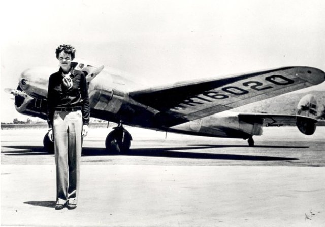 Amelia Earhart standing in front of the Lockheed Electra in which she disappeared in July 1937. Born in Atchison, Kansas in 1897, Amelia Earhart did not begin flying until after her move to California in 1920. After taking lessons from aviation pioneer Net
